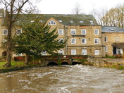 A VERY HIGH RIVER WENSUM AT FAKENHAM MILL