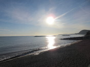Sun shines over the sea from Sidmouth's beach
