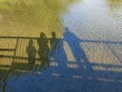 PROJ 52, SHADOWS, OF US ON THE BRIDGE OVER THE RIVER GLAVEN