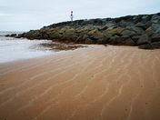 Salty lines on the beach at low tide