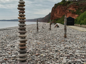 Pebble art on Budleigh beach picture by Tony Velterop