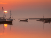 Rising sun at Brancaster Staithe