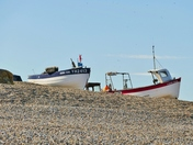 FISHING BOATS HIGH ON THE BEACH AT WEYBOURNE